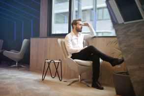 photo of a man sitting near the windoww